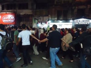Stand by your man: Male protesters form a ring around women marchers, Talaat Harb Street, November 27