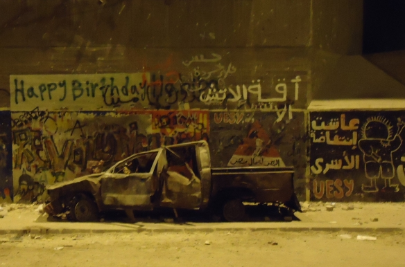 "Youssef el Guindy Street, off Mohamed Mahmoud, November 27. Among the graffiti: ""Long live the prisoners'   intifada""; ""Glory to the workers of Egypt"": © Scott Long"