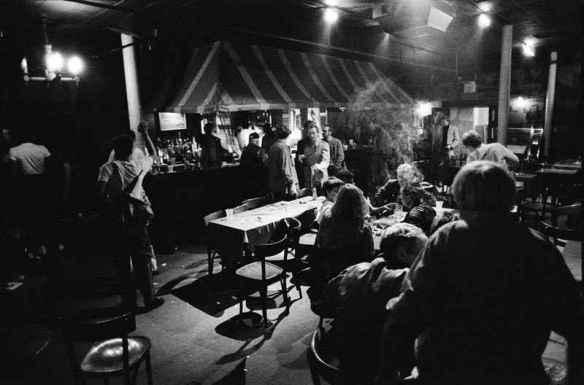 Casablanca bar in Harvard Square in the 1980s: my favorite bar. I am fairly sure that is me turned ghostlike by a plume of smoke at the center table. Photo by Eric Antoniou.