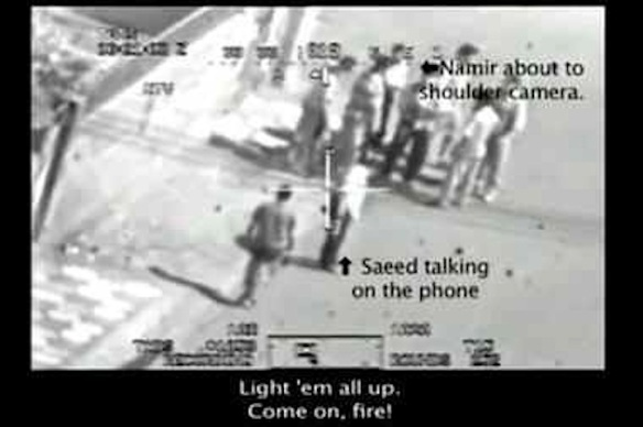 Manly men keep other men in their crosshairs: Frame from a video (released to WikiLeaks by Manning) shot by a US Army Apache helicopter shows civilians on an eastern Baghdad street, July 12, 2007.  Subtitle at bottom is dialogue within the helicopter. Moments later the gunship opened fire, killing eight, including two journalists.