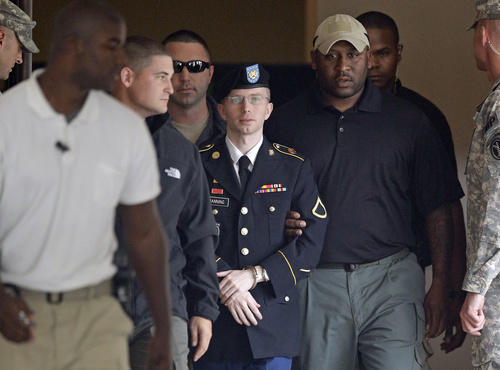 Manning being escorted from courthouse after a sentencing hearing, August 20, 2013, Fort Meade, MD