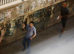 Armed civilians patrol the upscale Zamalek area of Cairo last week: © Manoocher Deghati