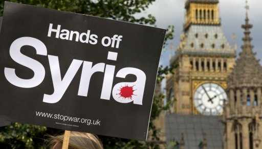 Demonstrator's sign outside the Houses of Parliament, August 29: AFP