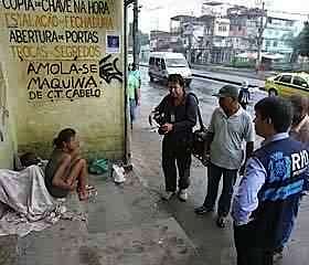 Shock and Order police, and reporters, with an alleged sex worker in Jacarézinho favela, 2009