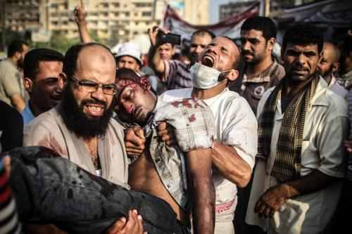 August 14: Protesters Rabaa El-Adawiya after the first army assault. From Mosa'ab Elshamy  at http://www.acus.org/egyptsource/photo-essay-eyewitness-account-rabaa-al-adaweya