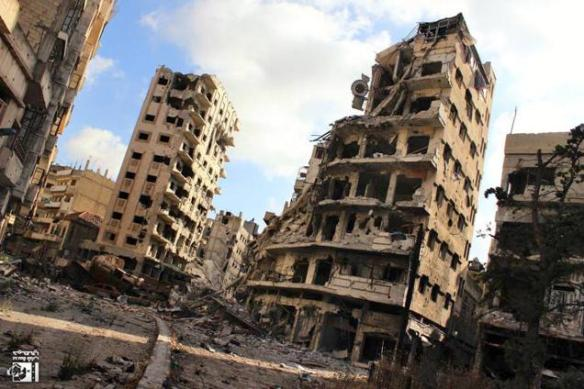 Citizen journalist image, provided by Lens Young Homsi, shows buildings destroyed by Syrian government bombing and shelling, in the Jouret al-Chiyah neighborhood of Homs, July 2013.