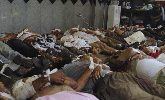 August 14: Corpses of Morsi supporters in a field hospital at Rabaa El-Adawiya. © Amr Abdallah Dalsh for Reuters.