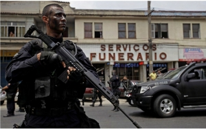 Men in black: BOPE (Special Police Operations Battalion) soldier near convenient local business