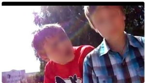 Still from a video of a 12-year old being threatened and abused in Tambov; faces not blurred in the original