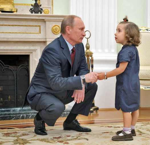 No, really. I have your best interests in mind: Putin with unconvinced child