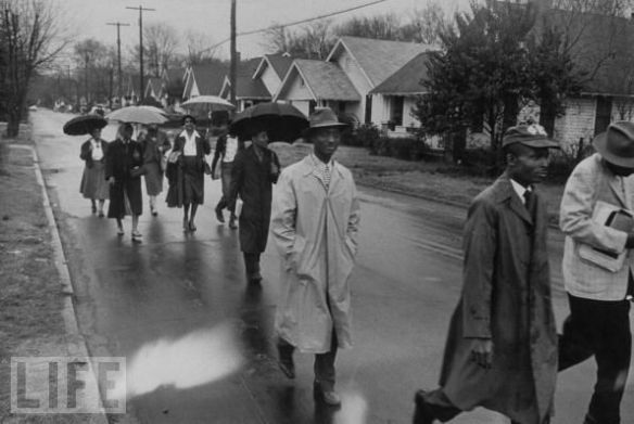 Men and women walking in the rain during the Montgomery bus boycott, 1956
