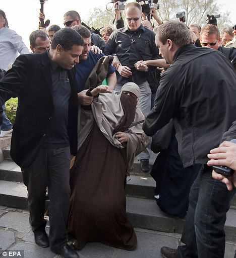 Police arresting a niqabi woman in Paris, April 12, 2011, © EPA