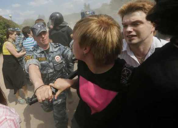 What's the matter, faggot, you didn't pay your fucking taxes? Police assault a marcher at St. Petersburg Pride, 2013. AP: Dmitry Lovetsky