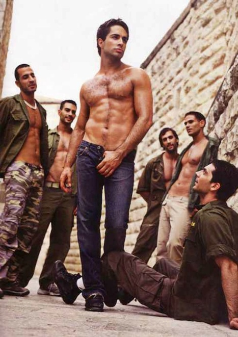 Don't ask, do sell: Michael Lucas with adoring soldiers, from ad for his tours of gay Israel