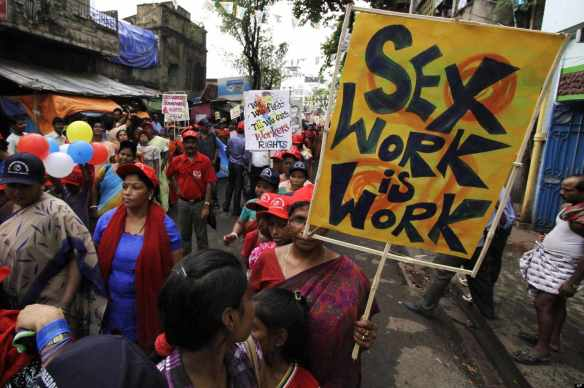 Fighting back: Sex workers rally in Kolkata, India, July 24, 2012. They participated in an alternative International AIDS Conference in protest against US visa restrictions that prevented attendance at the main conference in DC.