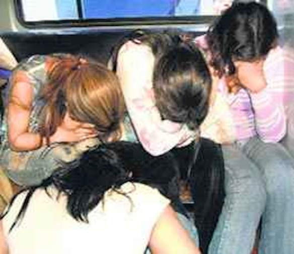 "Alleged sex workers arrested in a ""rescue"" raid on a lodging in Kathmandu, Nepal, September 15, 2013"