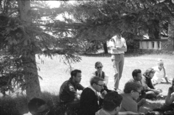 At the SDS National Convention, June 1965, Elk Rapids, Michigan: Doug Ireland is at the center, in dark glasses, vest, and tie. ©Bill XCiX Philiips (from Facebook)
