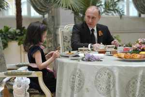 Putin with child: I won't eat you, if there are more like you at home