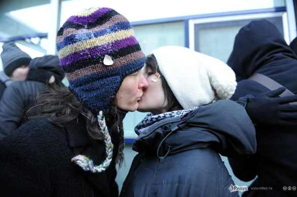 "Two women at the ""Day of Kisses"" demonstration in front of the Russian State Duma in January; one sports the remains of an egg thrown by right-wing protesters."