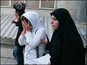 "Female basij (R) arrests a woman for ""bad hijab,"" revealing the hair, during a periodic crackdown in 2013"