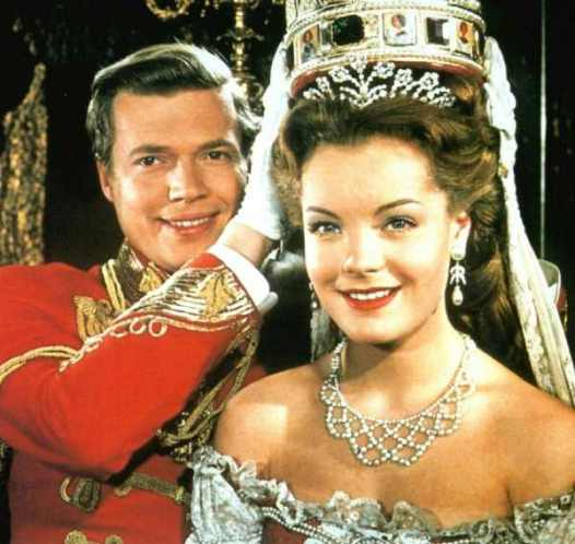 The General takes what's thrust upon him: Sisi (played by Romy Schneider) accepts power from a grateful people