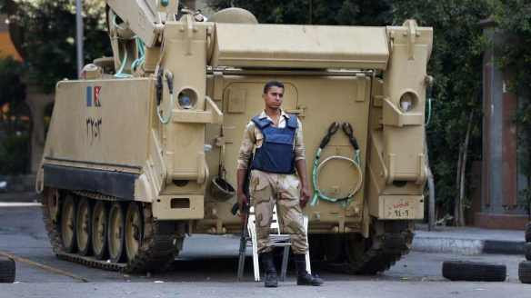 Soldier and armed personnel carrier at Cairo checkpoint