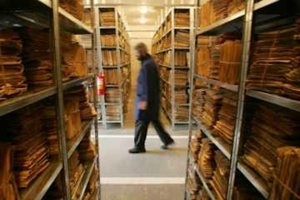 In the age of paper: Pre-revolution surveillance files at the National Center Studying the Securitate Archives, Bucharest, Romania (© Bogdan Cristel/Reuters).