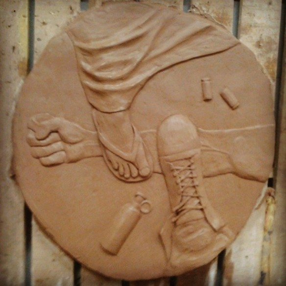 Clay relief by Egyptian artist Adam Dott, representing the current political situation in Egypt