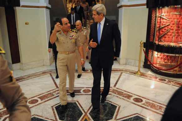I talk to chairs too, when I'm lonely: General el-Sisi (played by Bob Hoskins) talks to Clint Eastwood (played by John Kerry) in Cairo
