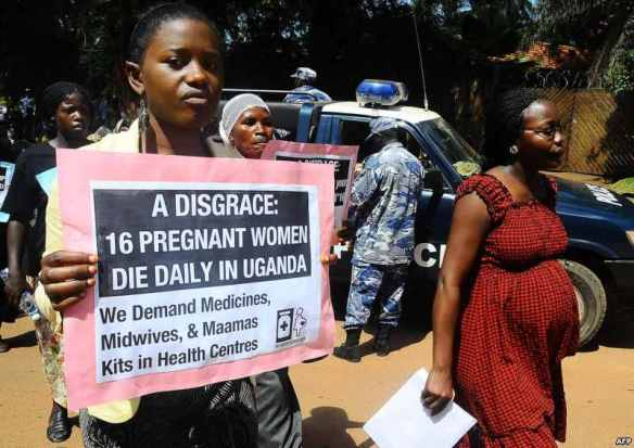 Participants in a march demanding health-care funding to fight maternal mortality, Kampala, Uganda, May 22, 2012