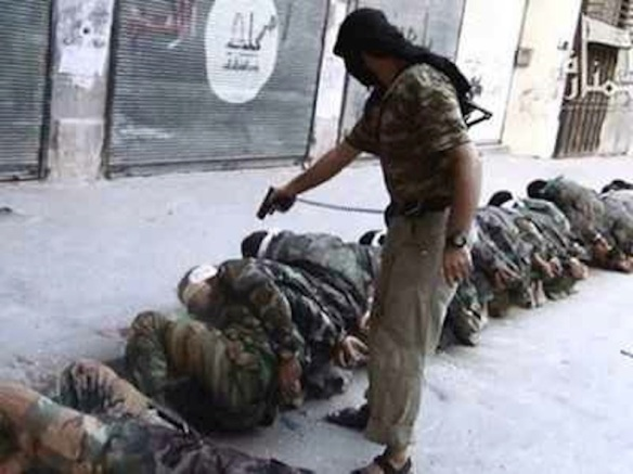 Fighter for Jabhat al-Nusra ((Support Front for the People of Levant) kills captured Syrian government soldiers, 2013