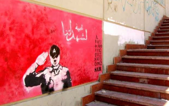 """A salute to our martyrs:"" A Hitler figure representing military and police delivers a hypocritical salute to the revolutionary dead. Graffiti in Sidi Gaber, Alexandria, from http://suzeeinthecity.wordpress.com/"