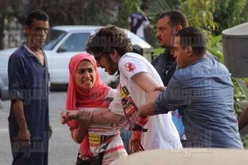 Security forces seize Omar Morsi at the march. Salwa Mehrez, left, was also arrested because she refused to leave him.