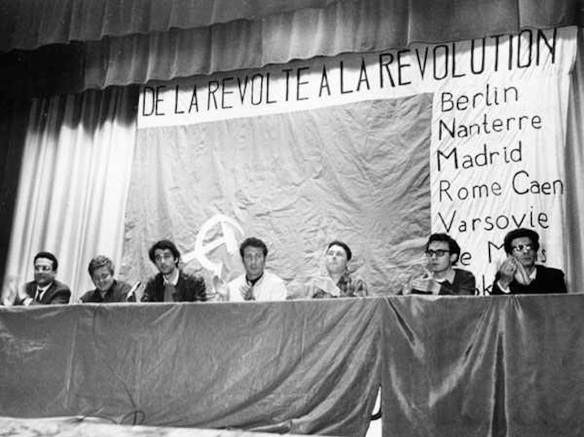 Paris, 1968, at a mass meeting held by Jeunesse Communiste Révolutionnaire: from the left, Ernest Mandel, Daniel Cohn-Bendit, Henri Weber, and Bensaïd
