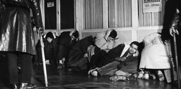 October 17, 1961: arrested pro-Algerian demonstrators huddle on the floor of Paris police headquarters. Many would soon be shot in the courtyard.