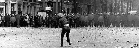 Student demonstrator confronting riot police, Paris, May 1968