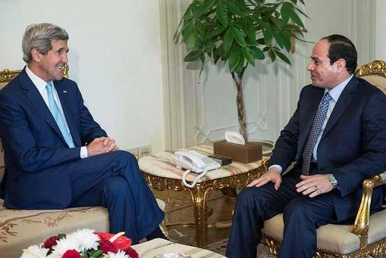 Boys will be boys: Men's rights activists John Kerry and General Abdelfattah el-SIsi meet in Cairo, June 22
