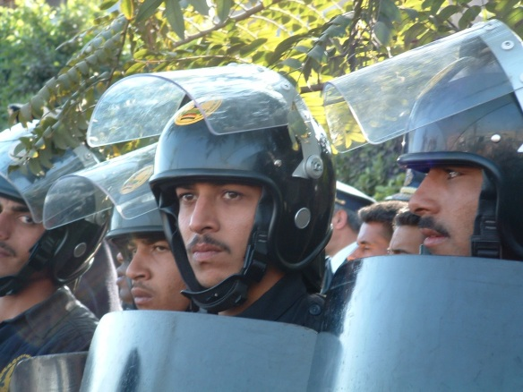 Security forces encircling an antiwar protest at the Cairo Book Fair, Egypt, January 31, 2003: Photograph by Scott Long
