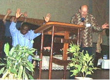 Tony Abram (R, need I say) with worshippers in Zambia, 2005