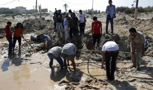 Palestinians search for bodies in the southern Gaza Strip, at a beach cafe hit the night before by an Israeli air strike: July 10, 2014