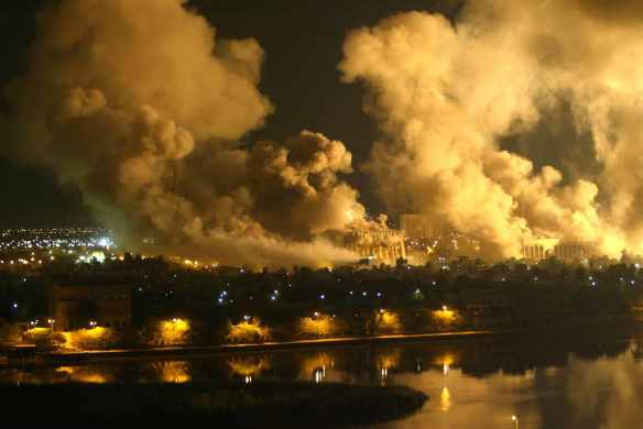 Shock and awe: Smoke covers central Baghdad during a massive U.S.-led air raid, March 21, 2003. Photo by AFP.