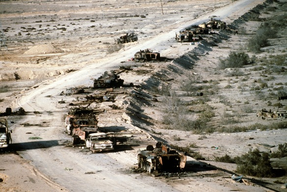 Iraqi armored personnel carrieres, tanks, and trucks destroyed on the Highway of Death from Kuwait, during Operation Desert Storm , 1991: Photo by US Department of Defense