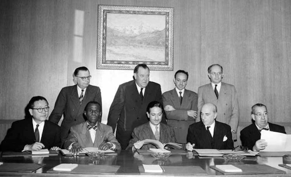 Meeting of signatories  to the UN Genocide Convention, 1950. Seated, L-R: representatives of Korea; Haiti; Iran; France; Costa Rica. Standing, L-R:  Assistant Secretary General for Legal Affairs; Secretary General Trygve Lie; representative from Costa Rica; and Raphael Lemkin, the Convention's chief proponent.