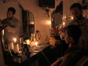 Don't blame Sisi: Cairenes light candles during a blackout. Photo by Islam Farouk for Al-Masry al-Youm.