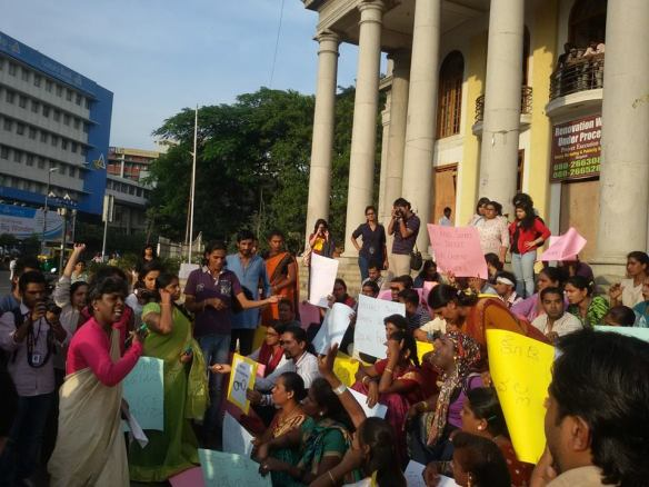Protest in front of Bangalore Town Hall, November 26, from the Facebook page of Akkai Padmashali (speaking, lower L)