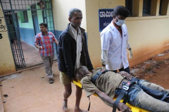 Inmate of the Beggars Colony in Bangalore being removed to a hospital for treatment, under media pressure, in August 2010. Photo by K Murali Kumar,  The Hindu, December 28, 2010