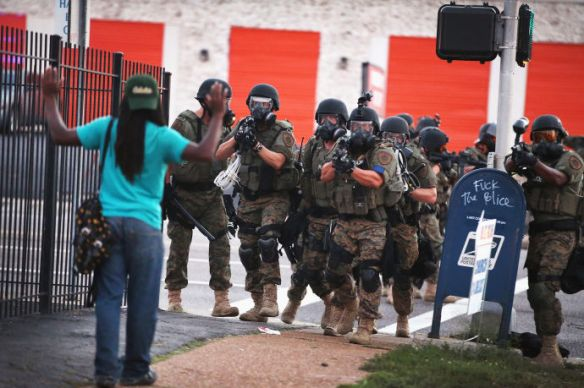 Police power II: Police force protesters off the streets of Ferguson, Missouri, August 11, 2014. Photo by Scott Olson/Getty