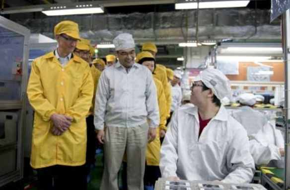 Hello down there, little man: Tim Cook tours a Foxconn factory in Zhengzhou, China, in 2012
