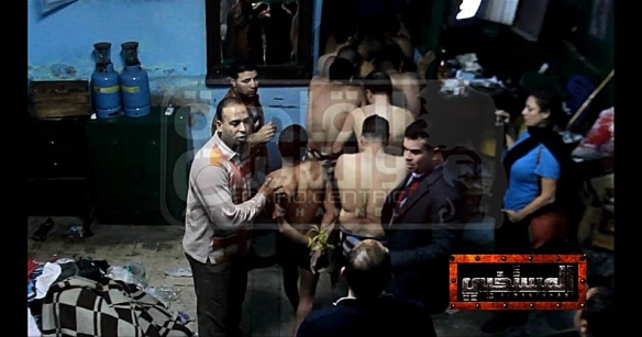 The December 7 bathhouse raid: Photo from Mona Iraqi's Facebook page. Iraqi is on the right.