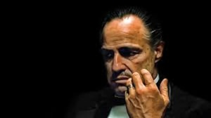 The godfather gives the four-finger Muslim Brotherhood salute, while making an offer you can't refuse